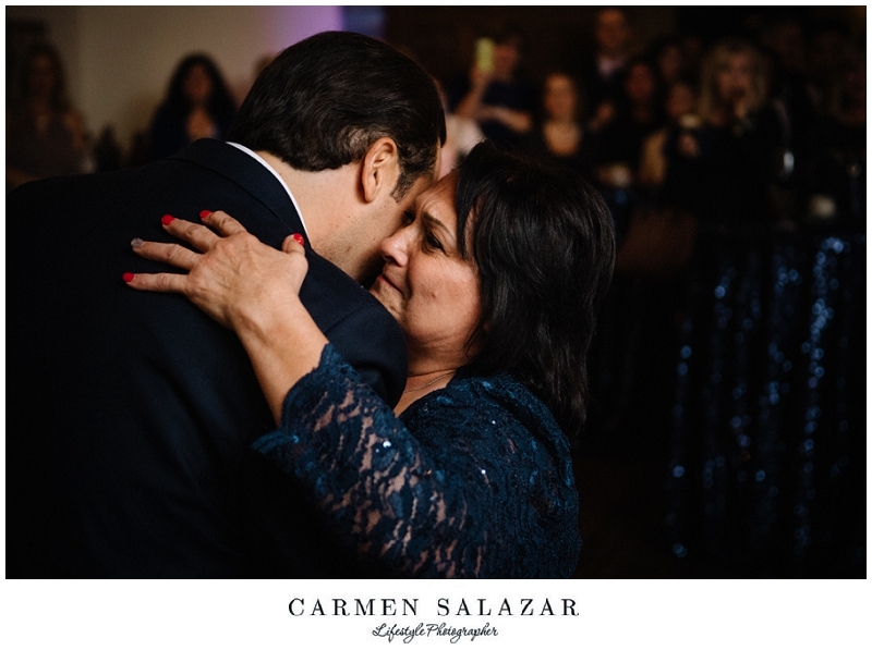 groom embraces his mother at a Sutter Club reception