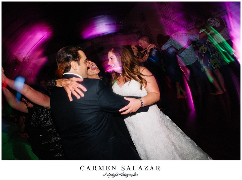 fun reception photo with bride and groom by Carmen Salazar