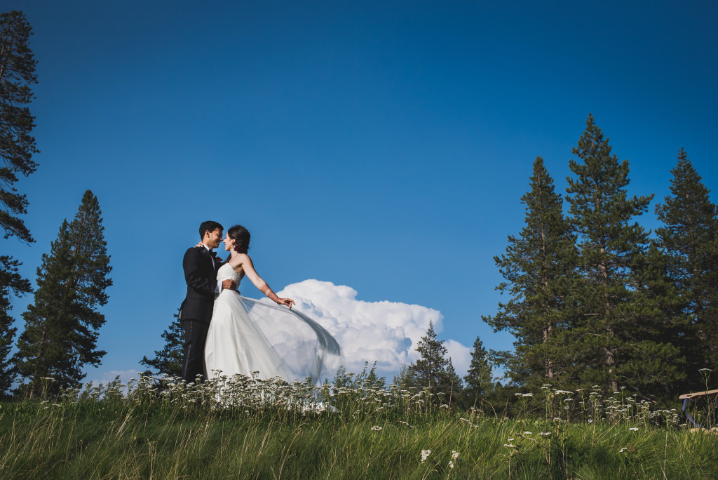 Romantic Lake Tahoe wedding photo of couple on hill
