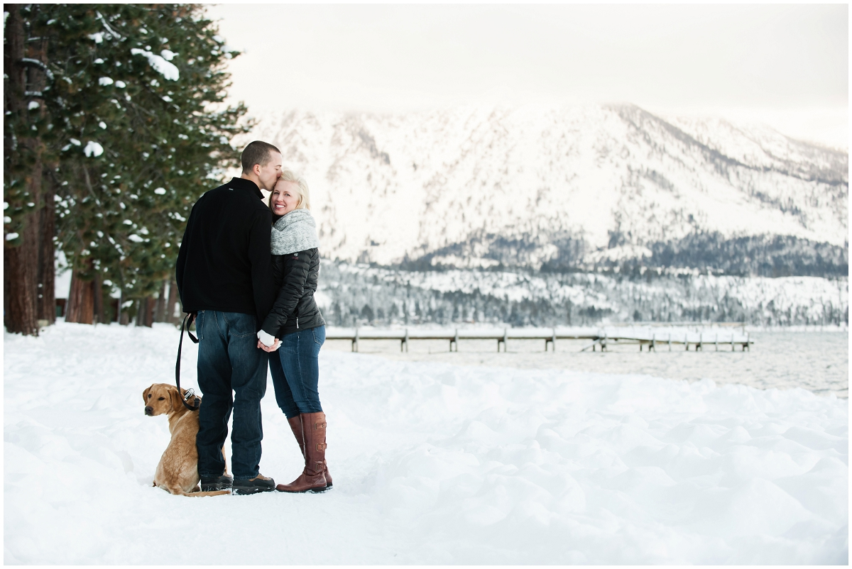 Snowy Lake Tahoe engagement photo with puppy dog