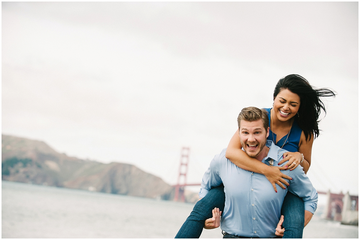 Laughing couple at the Golden Gate Bridge