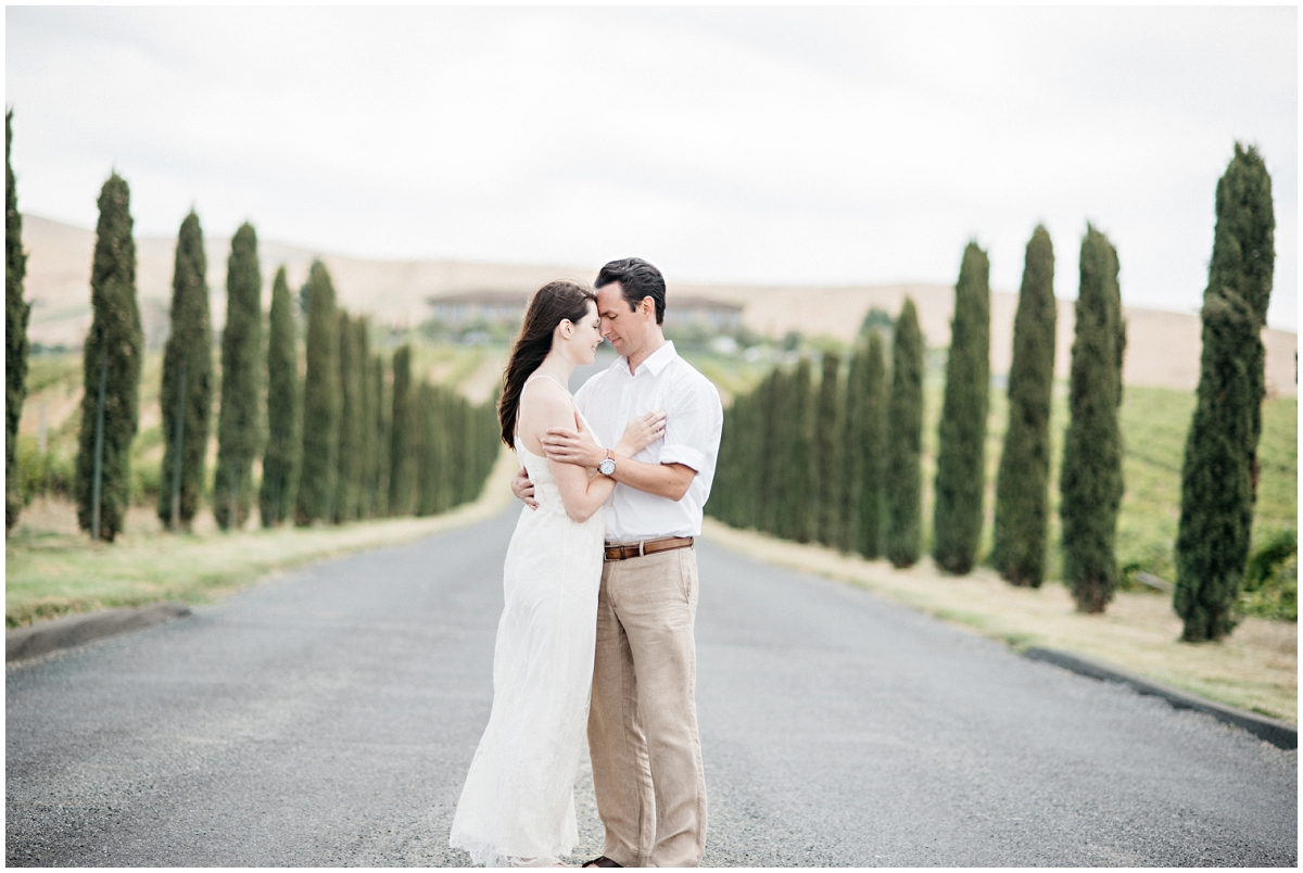 Winery engagement photos with tree lined street