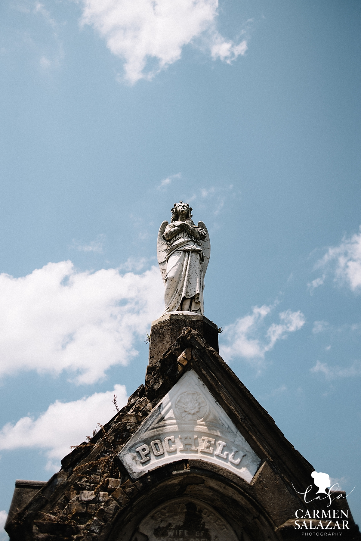 Mausoleum angel in New Orleans by Carmen Salazar