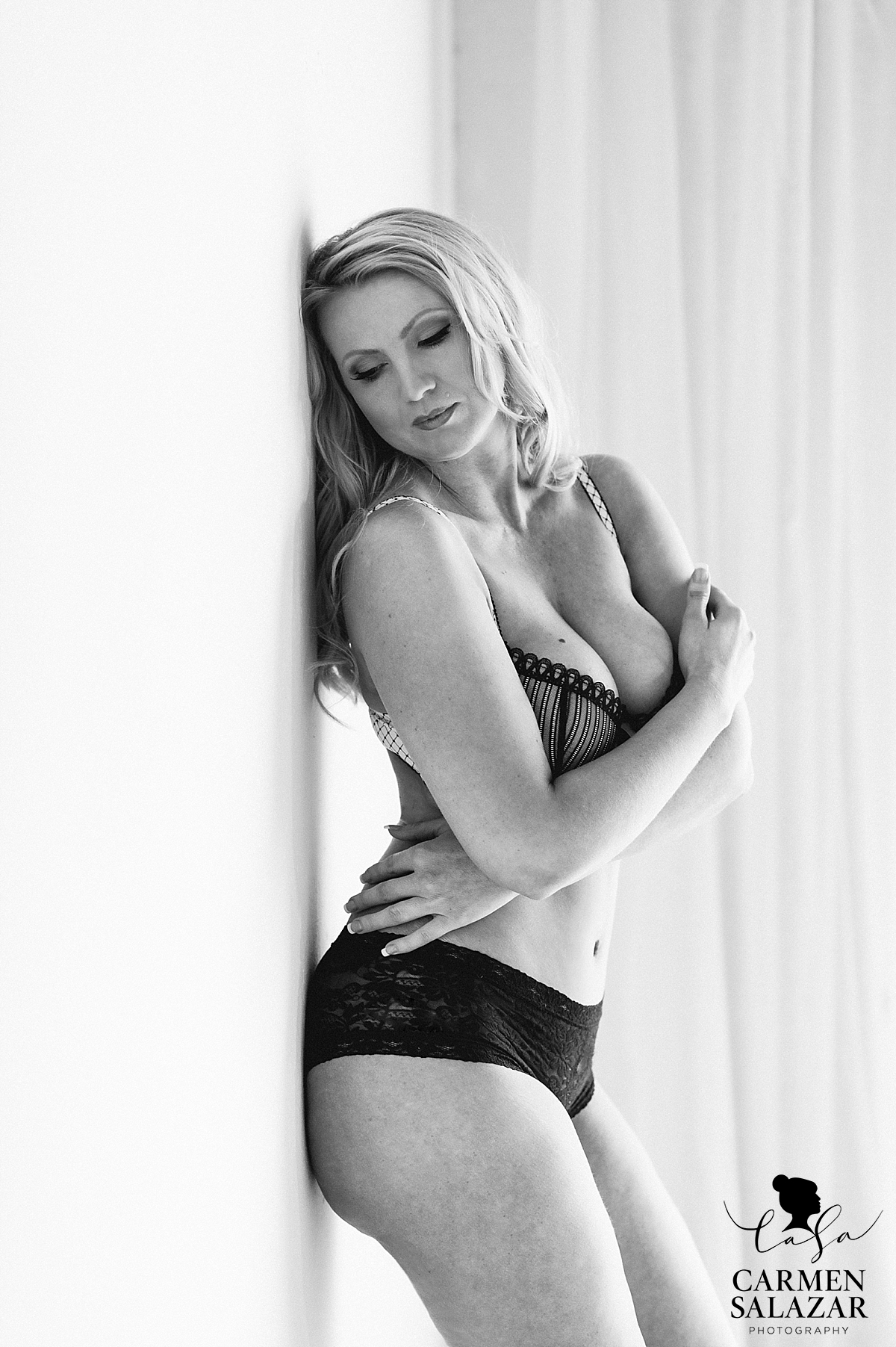 Classic Black and white boudoir picture with black lingerie