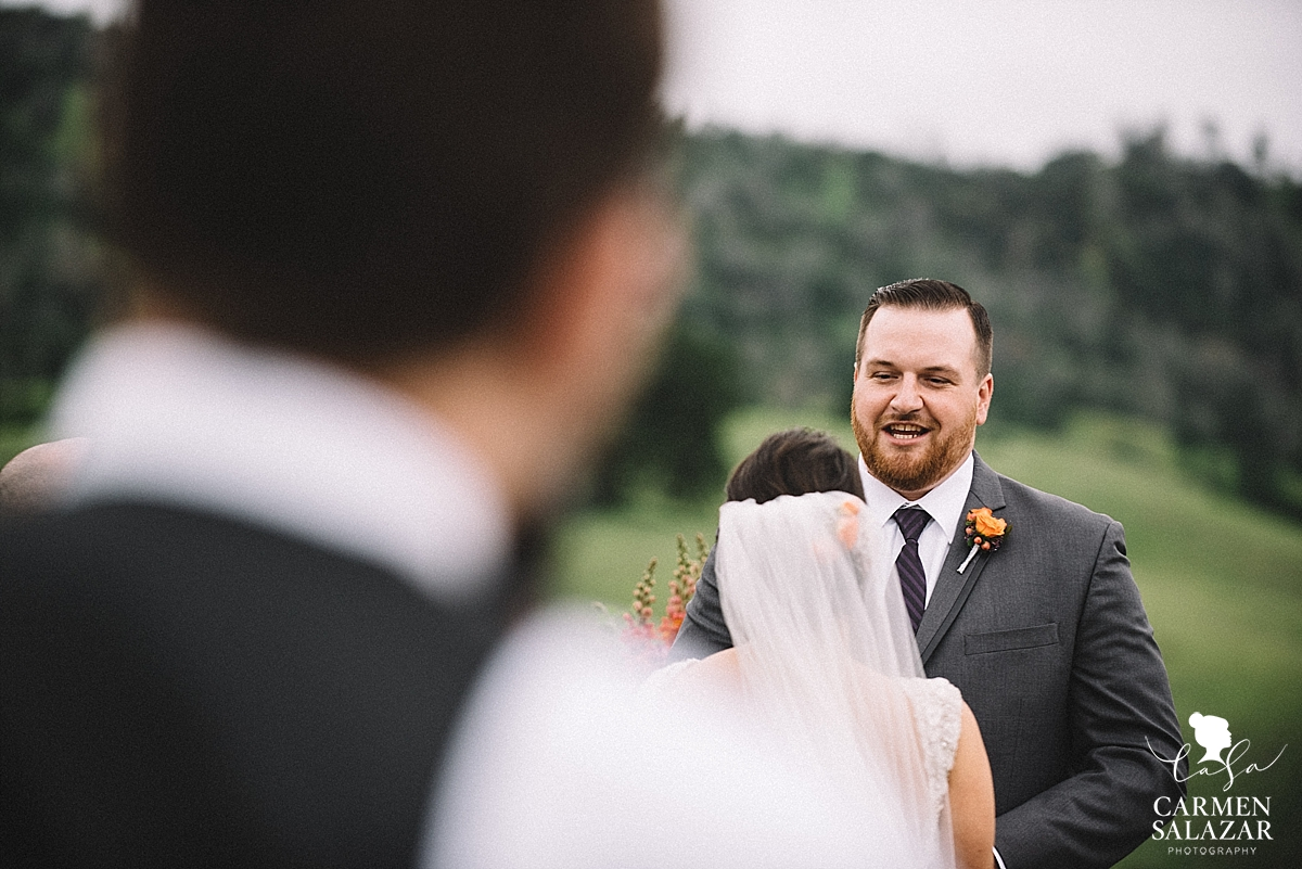 Emotional groom saying vows - Carmen Salazar