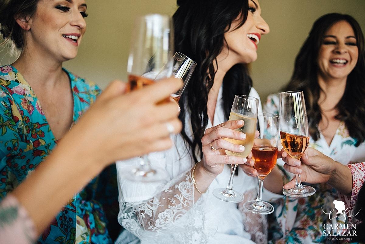 Fun bridesmaids toasting at Field & Pond