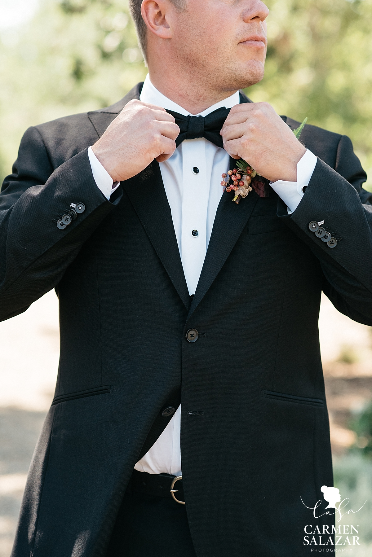 Groom getting ready for first look at bride