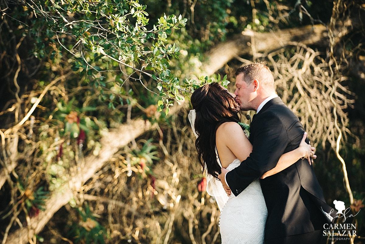 First kiss at boho Field & Pond wedding - Carmen Salazar