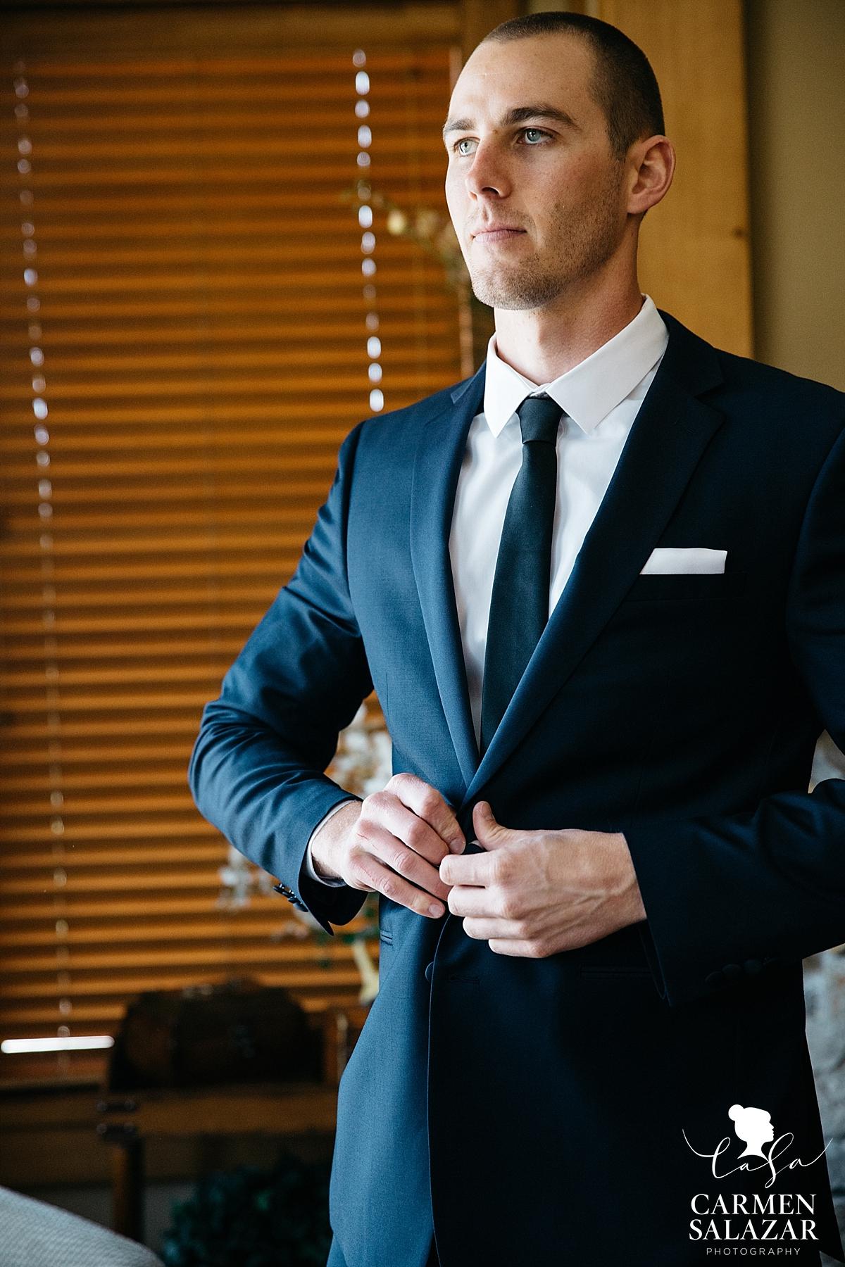 Dapper groom getting ready in Tahoe - Carmen Salazar