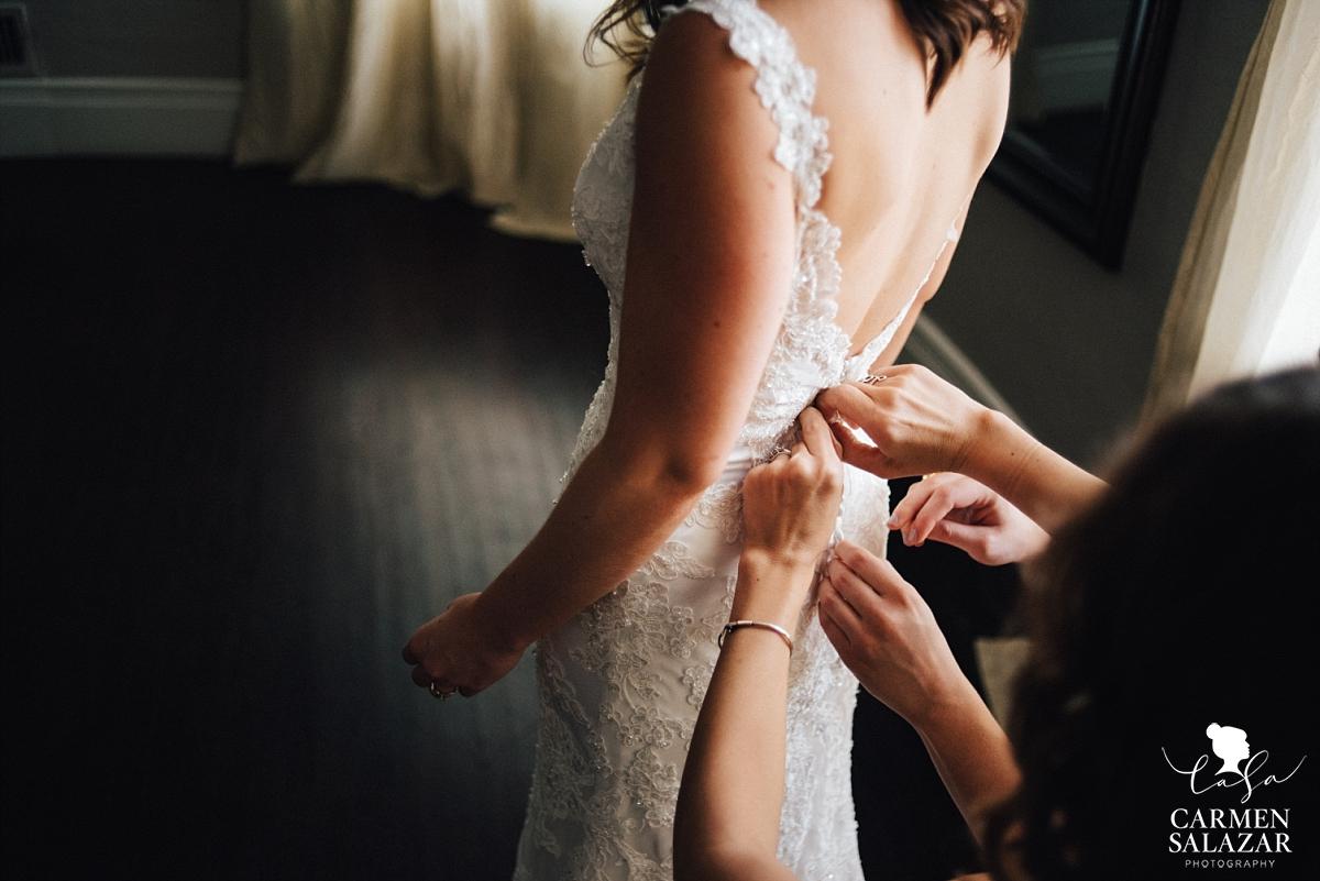 Buttoning the vintage lace gown - Carmen Salazar