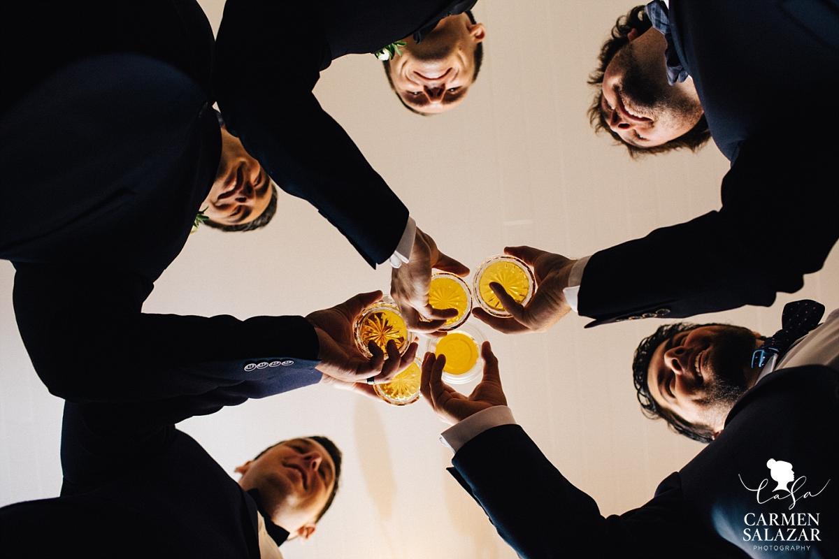 Groomsman toasting with scotch at a Summer Sacramento Wedding