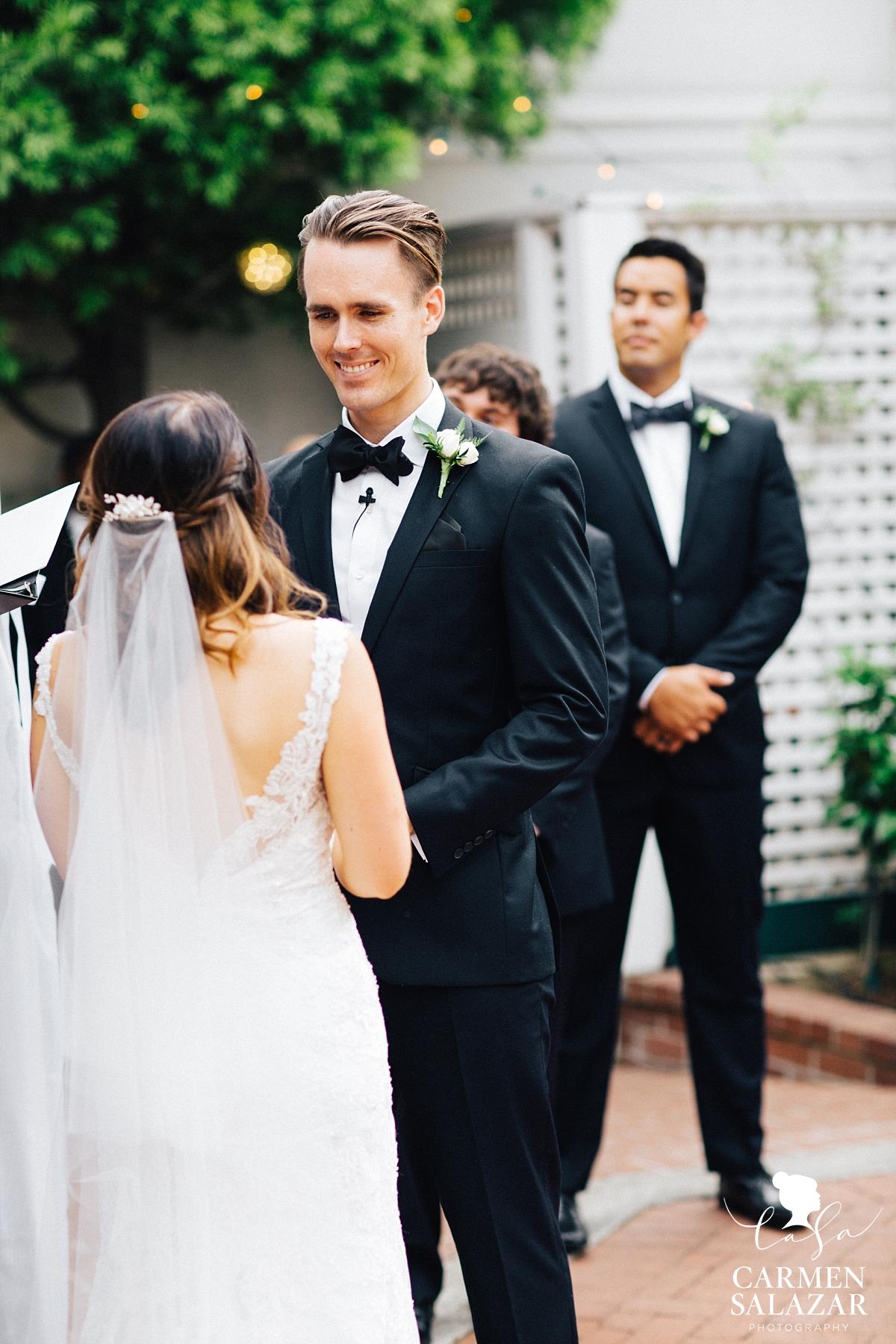 Handsome groom at ceremony - Carmen Salazar