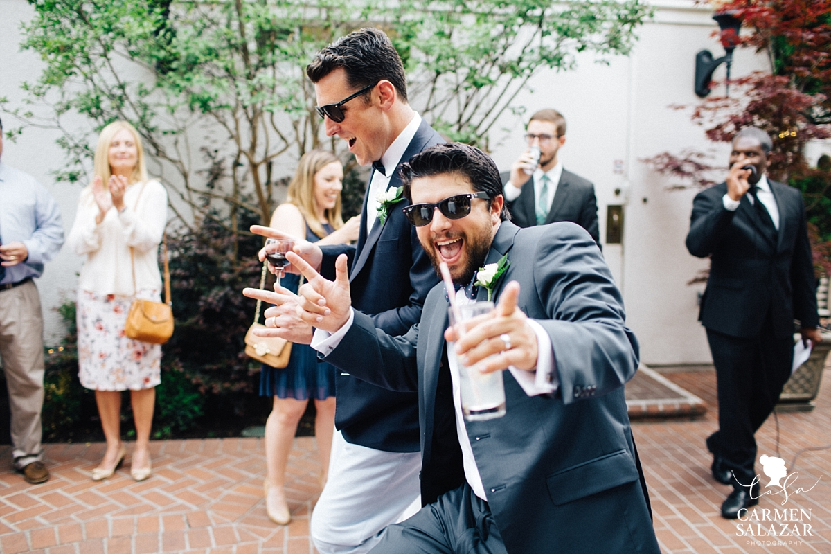 fun groomsmen entrance at cocktail hour