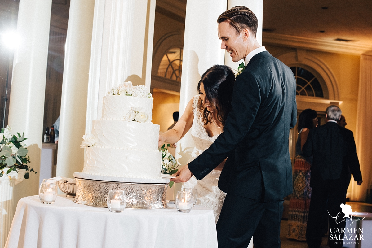 Bride and groom cutting cake at Vizcaya - Carmen Salazar