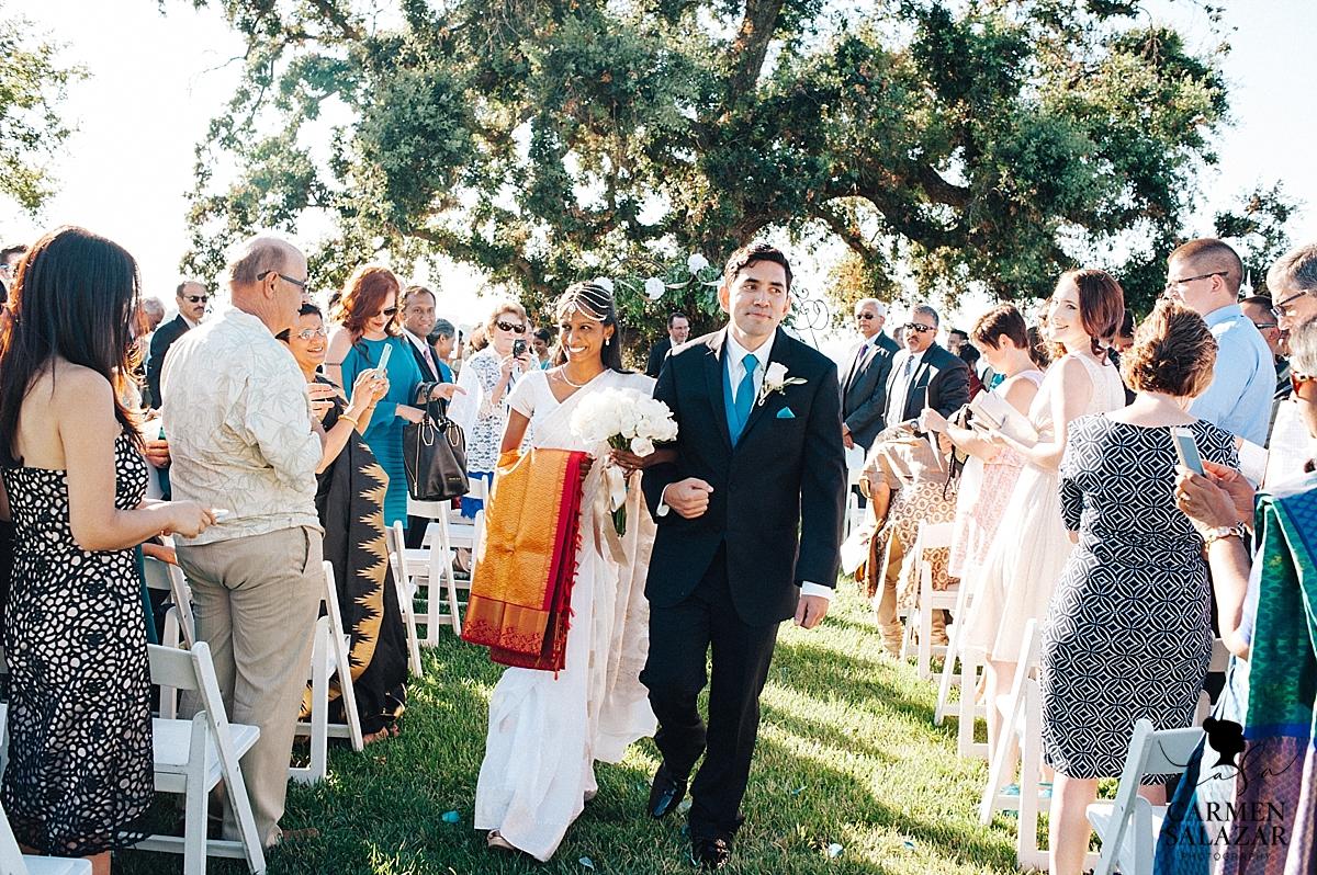 Newlyweds at Christian-Indian wedding ceremony - Carmen Salazar
