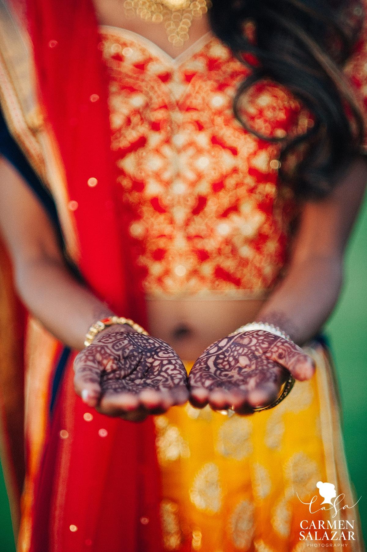 Vibrant sari and ornate henna details - Carmen Salazar