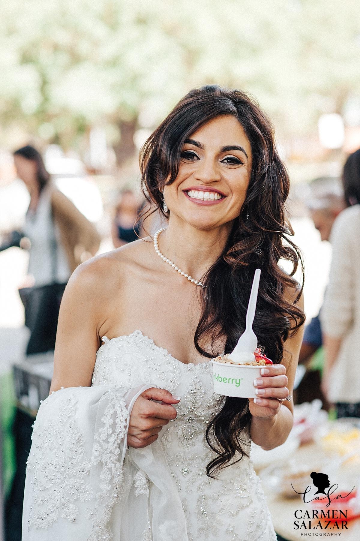 Smiling bride with Pinkberry yogurt - Carmen Salazar