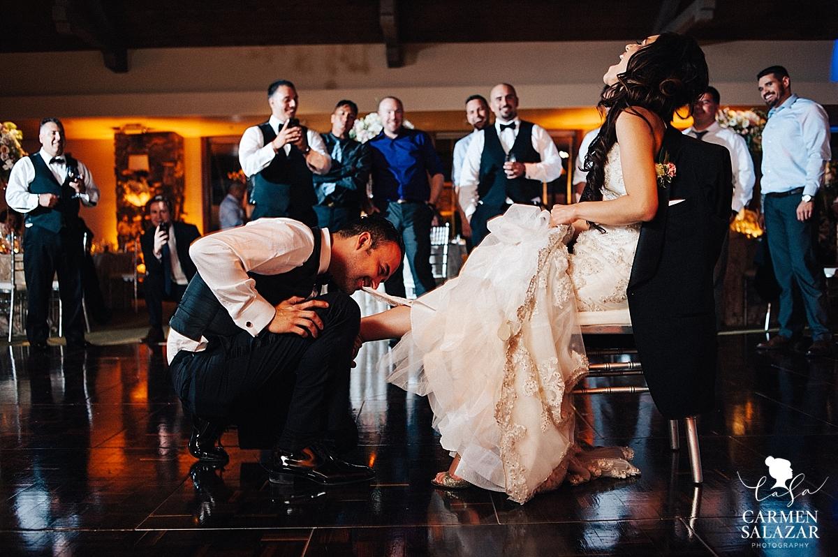 Garter toss at Lodi ballroom wedding reception - Carmen Salazar