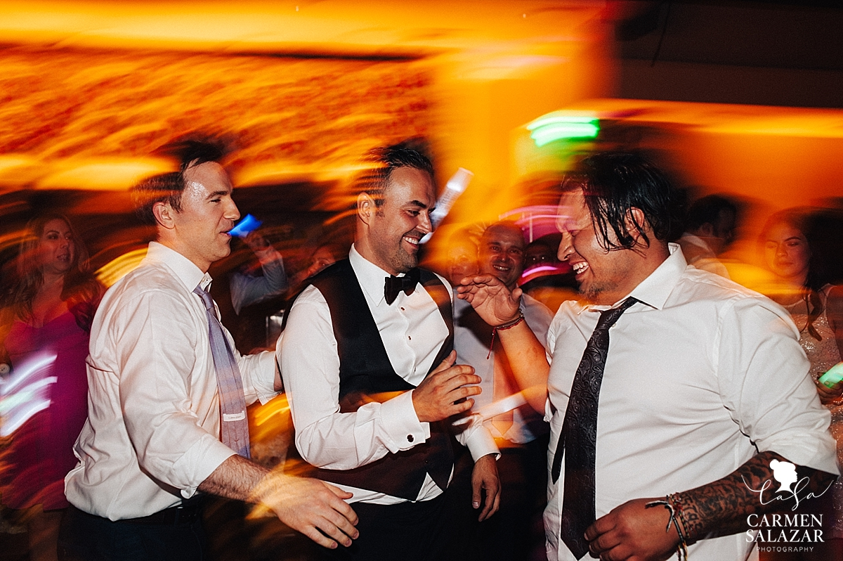 Groom dancing with guests at Wine and Roses reception - Carmen Salazar