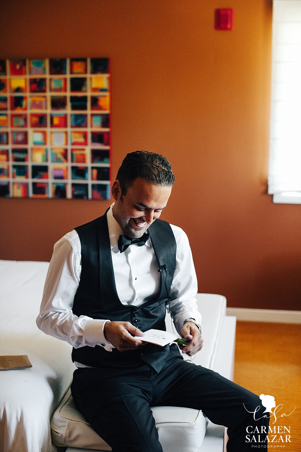 happy groom reading love note from bride at Lodi wedding