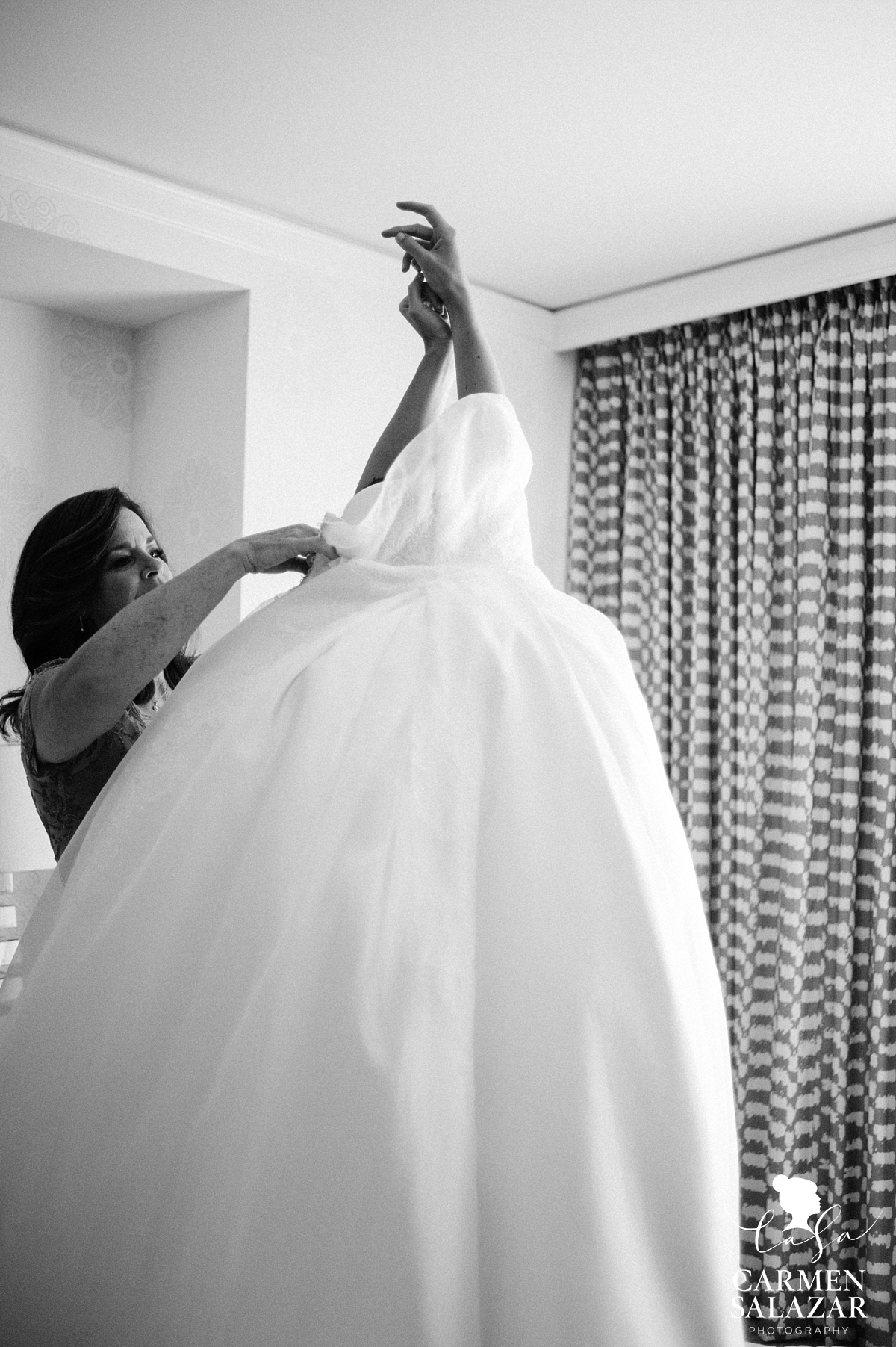 Bride getting dressed at Fairmont- Carmen Salazar