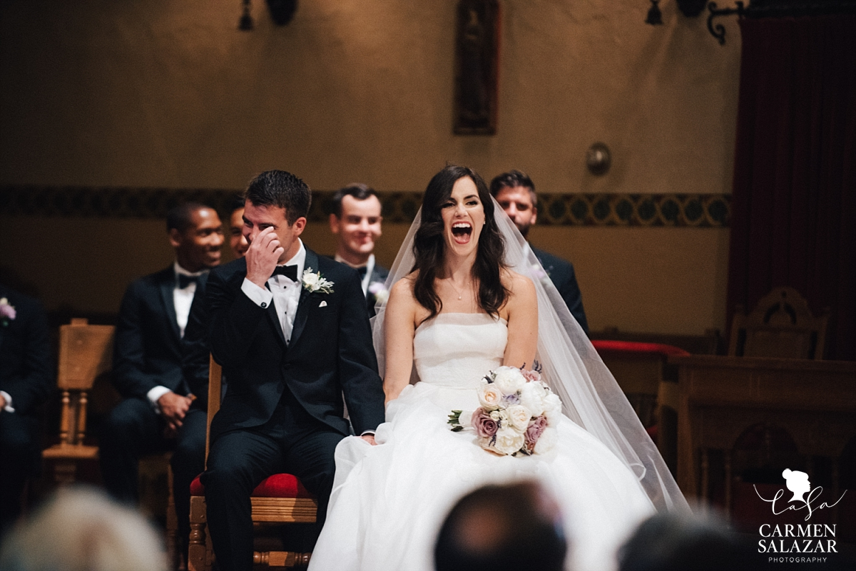 Laughing bride and groom at Catholic ceremony - Carmen Salazar
