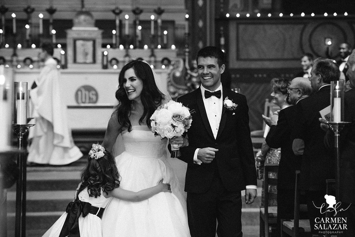 Happy newlyweds walking down aisle - Carmen Salazar