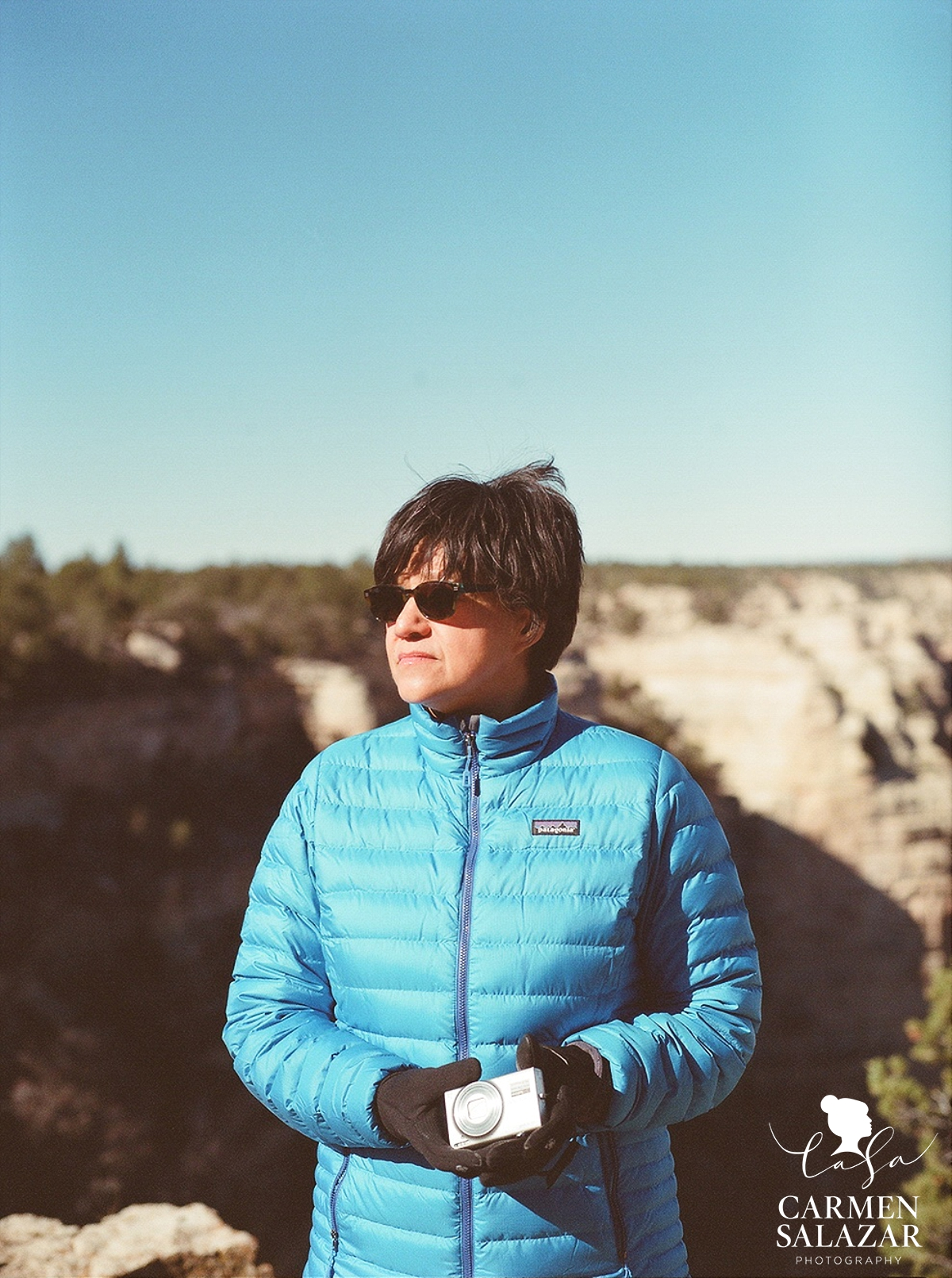 portrait of woman at grand canyon with camera by Carmen Salazar