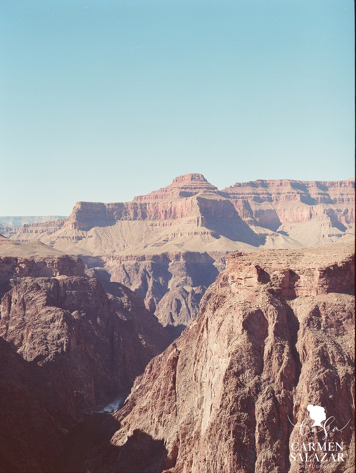 hiking at grand canyon with camera by Carmen Salazar