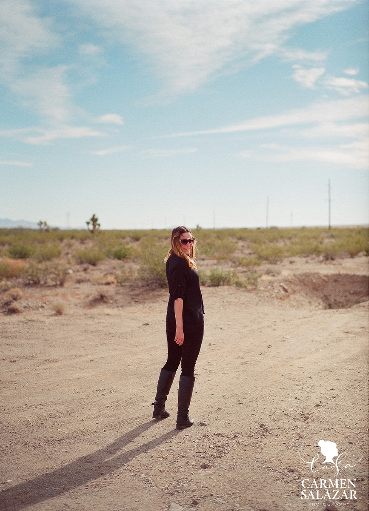 fun portrait of blond girl in the desert by Carmen Salazar Photography