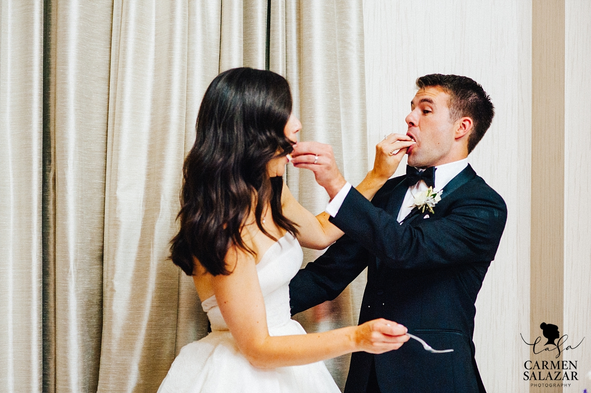 Bride and groom tasting wedding cake at Westin - Carmen Salazar