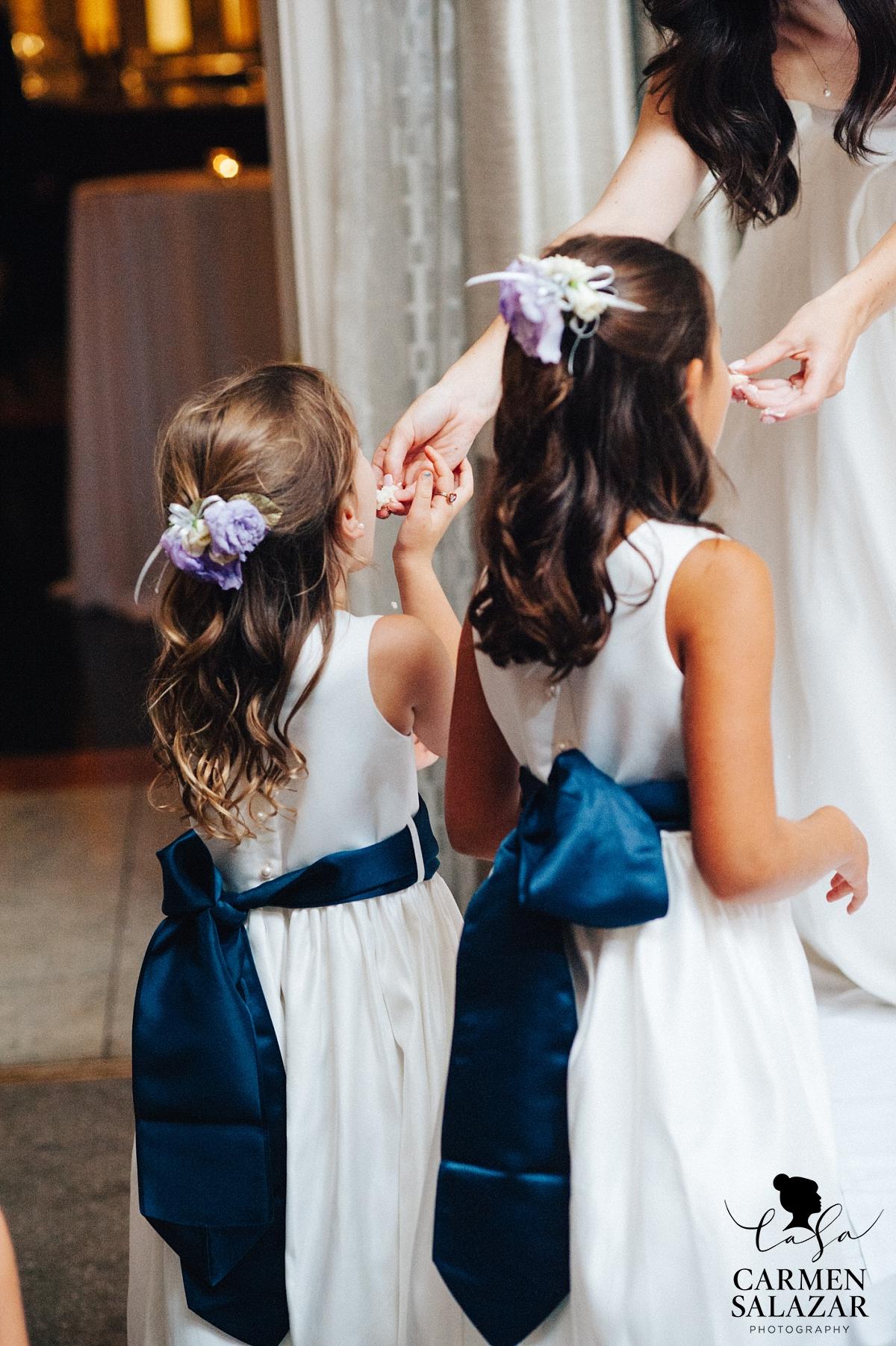 Bride feeding flower girls wedding cake - Carmen Salazar