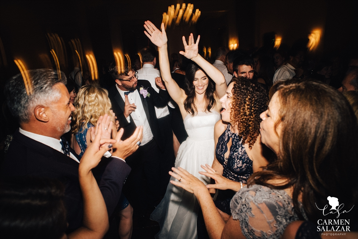 Beautiful bride dancing with friends - Carmen Salazar