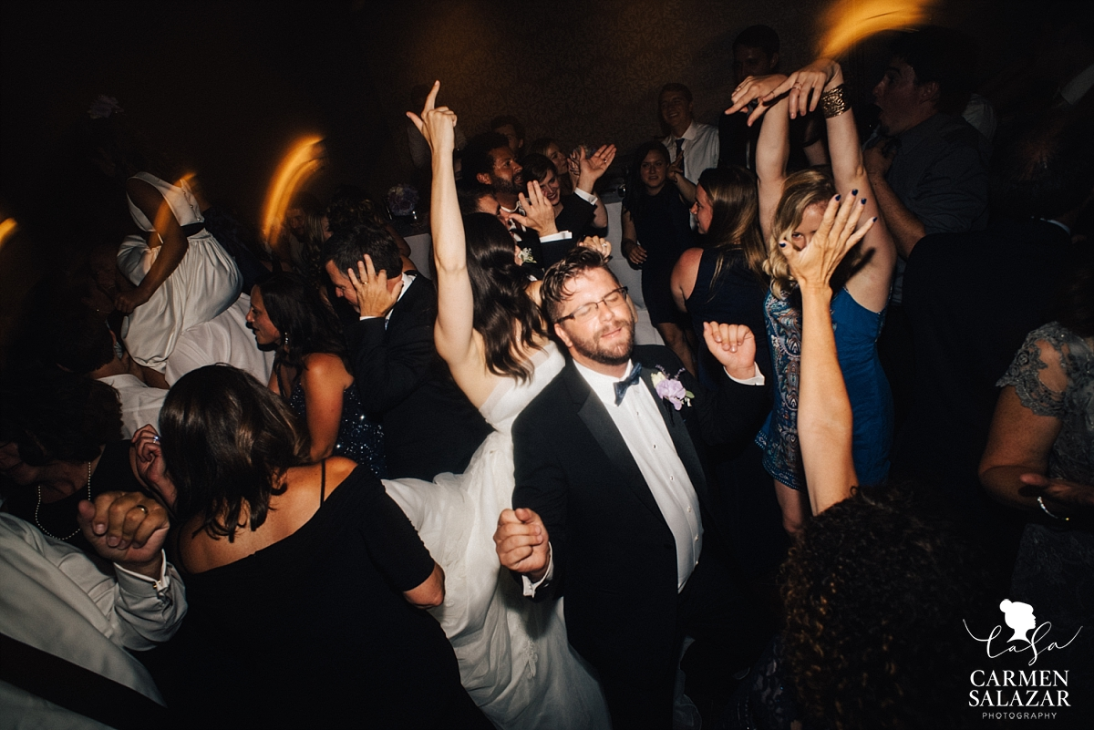Groomsman dancing silly at Westin - Carmen Salazar