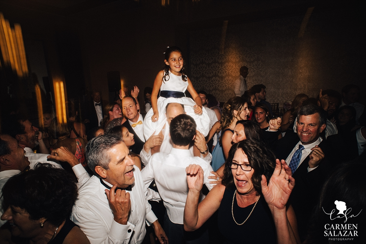 Flowergirl running the dance floor on shoulders - Carmen Salazar