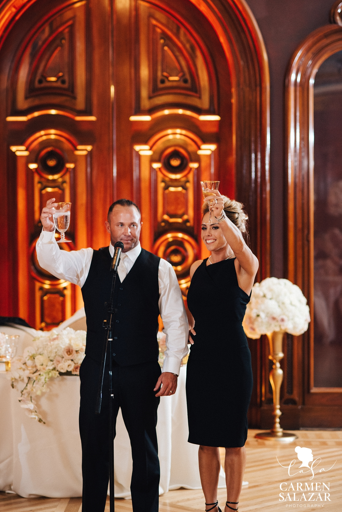 Bride and groom toasting at art museum reception - Carmen Salazar