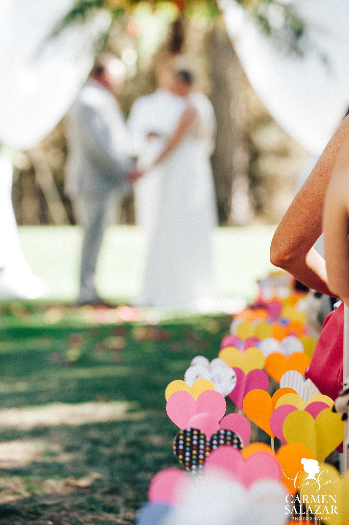 Cute DIY aisle hearts at wedding ceremony - Carmen Salazar