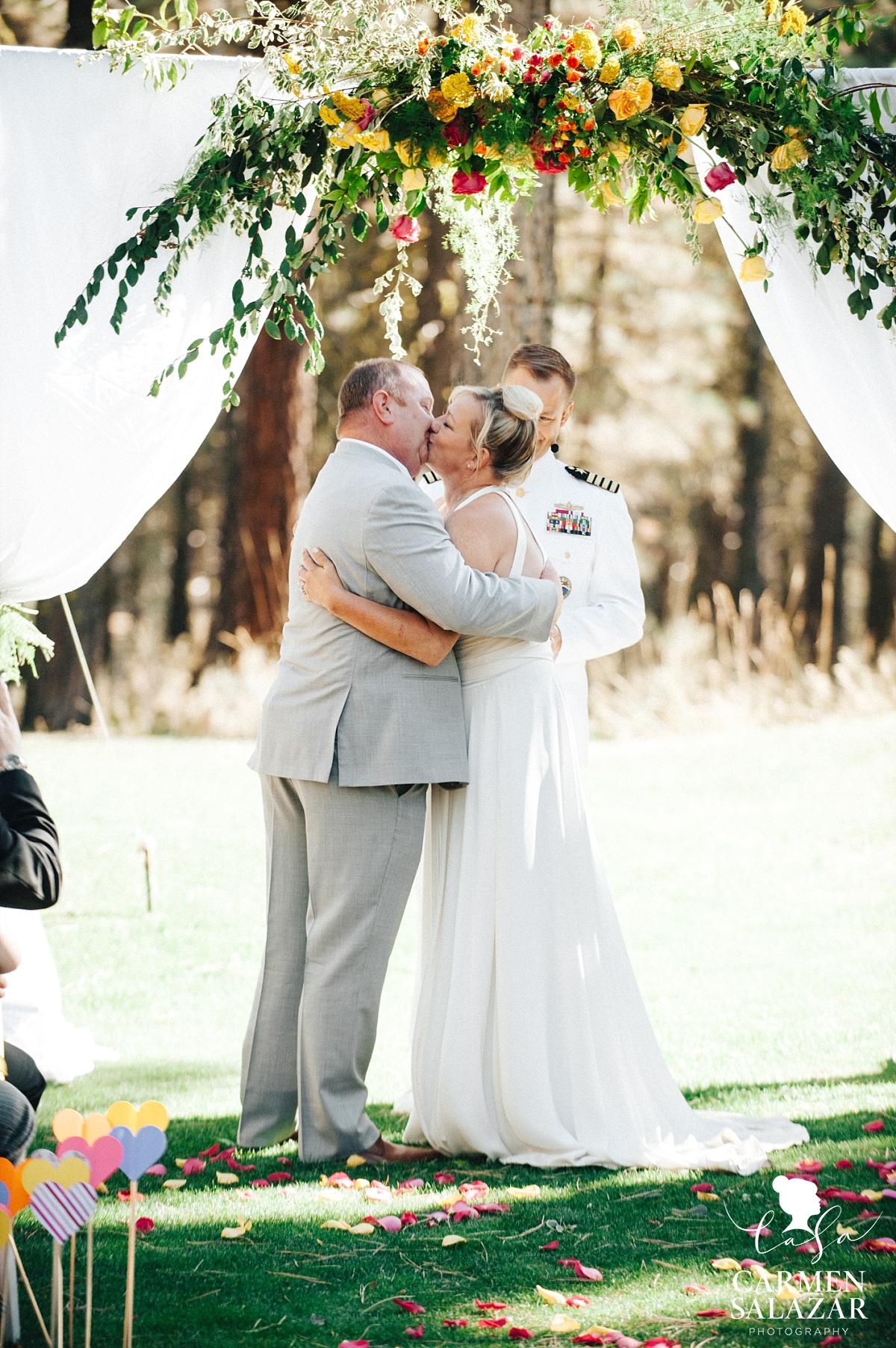 First kiss at Chalet View Lodge fall wedding - Carmen Salazar