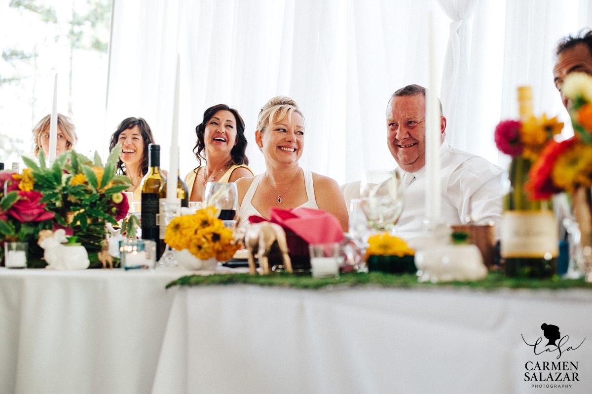 Happy bride and groom at DIY design head table - Carmen Salazar