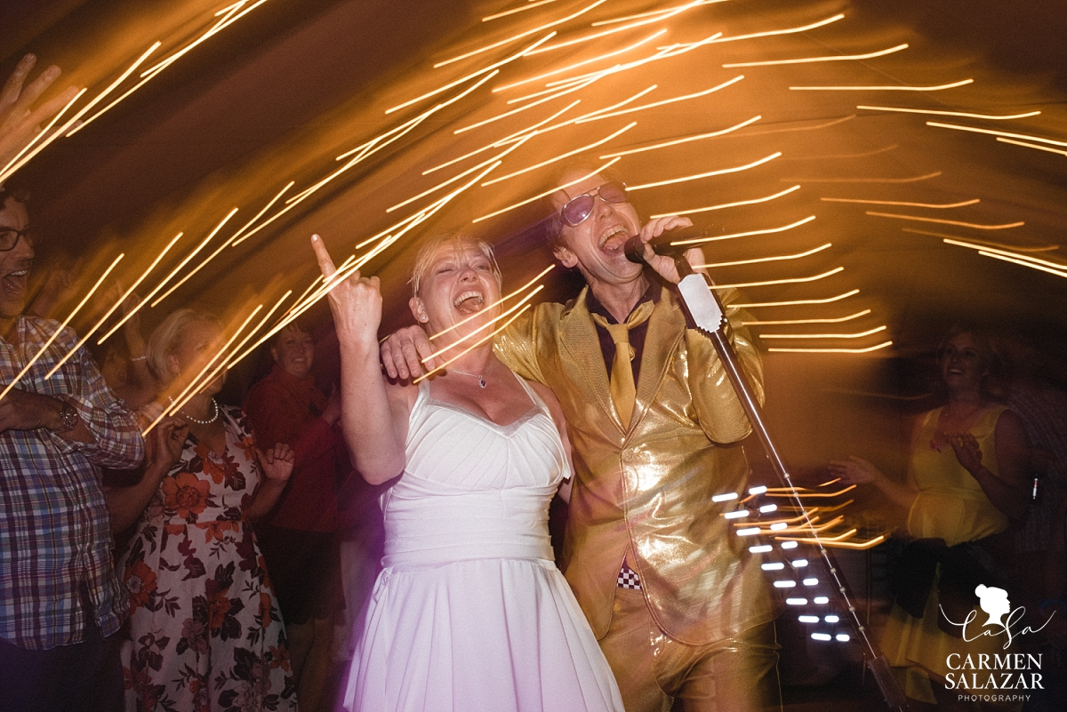 Bride singing with Pop Rocks cover band at Chalet View Lodge reception - Carmen Salazar