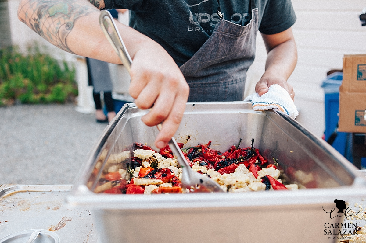 Catering behind the scenes photo of a chef at a wedding - Carmen Salazar
