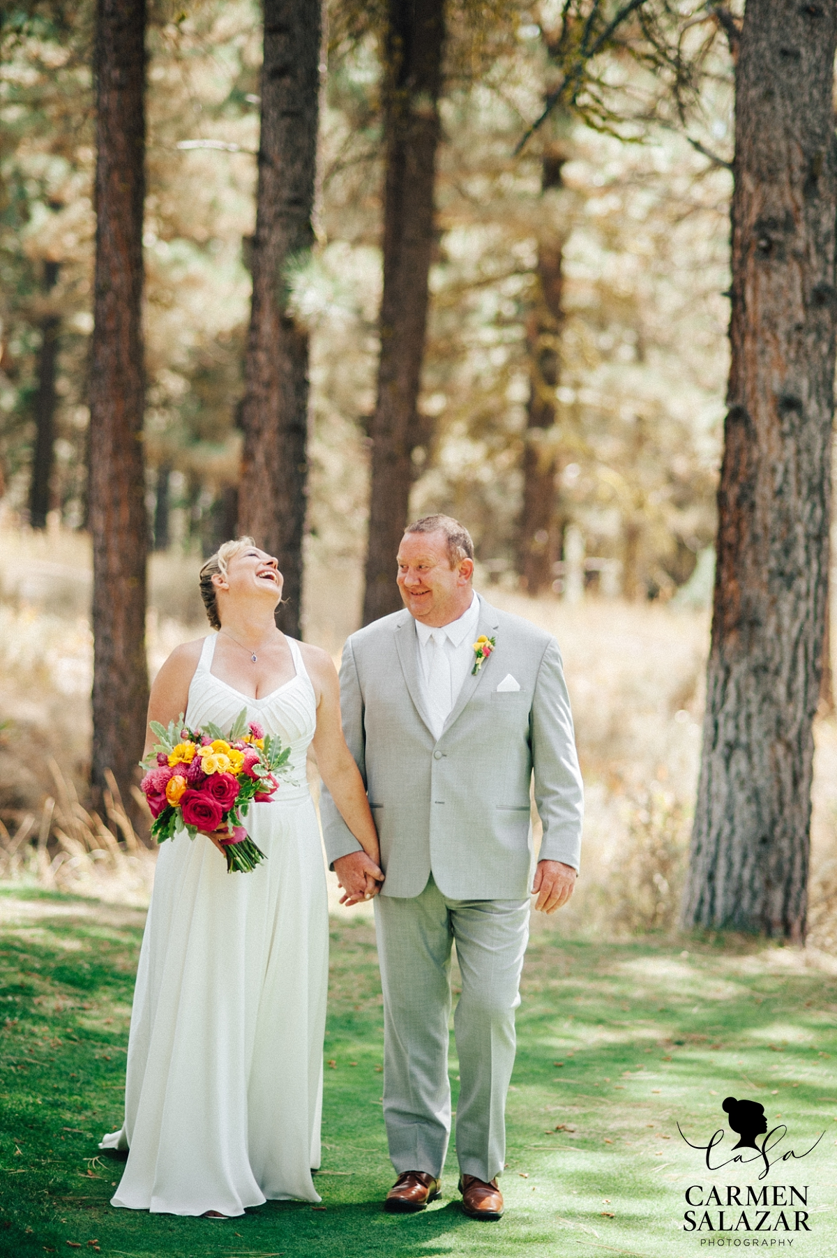 Bride and groom laughing at Tahoe ceremony - Carmen Salazar