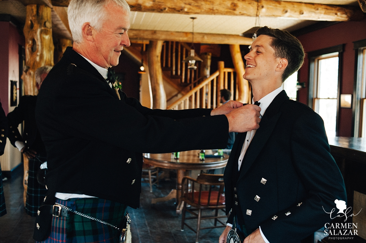 Father of the bride helping groom get ready - Carmen Salazar