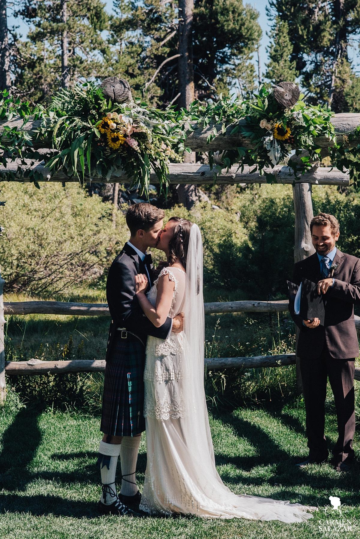 First kiss at the Hideout Scottish wedding - Carmen Salazar