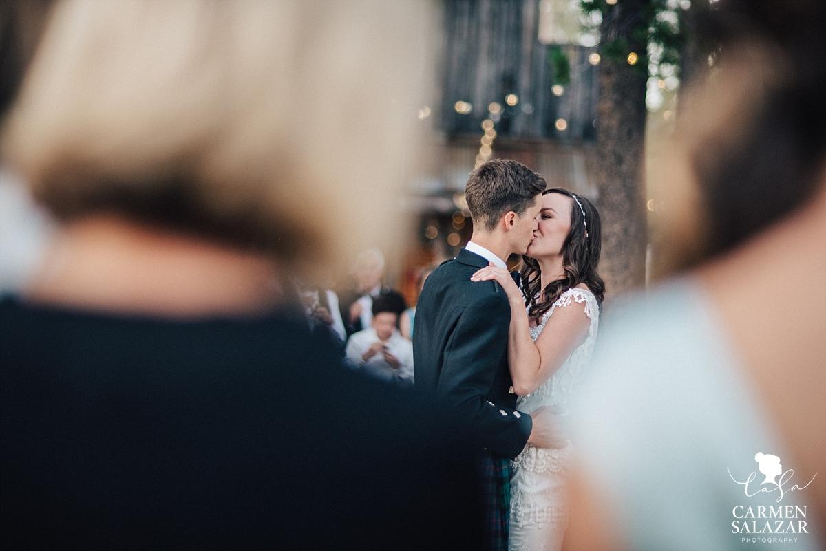 Wedding cake kiss at summer Tahoe reception - Carmen Salazar