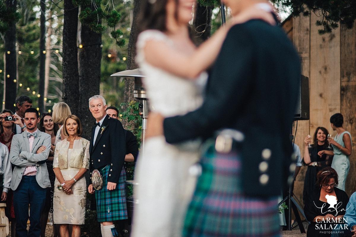Wedding guests watching first dance - Carmen Salazar