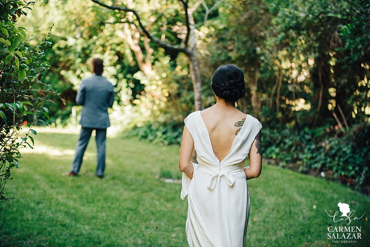 Tattooed bride walking to first look with groom - Carmen Salazar