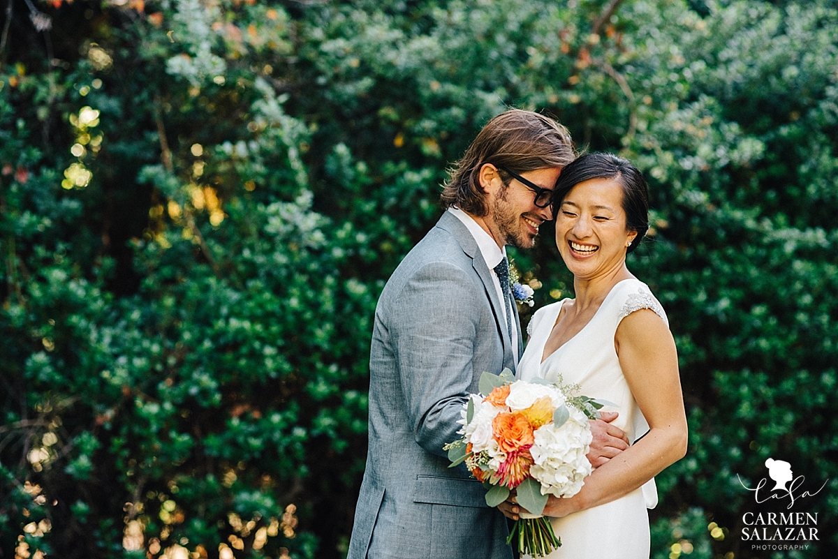 Romantic outdoor photo of laughing bride and groom at a California wedding - Carmen Salazar