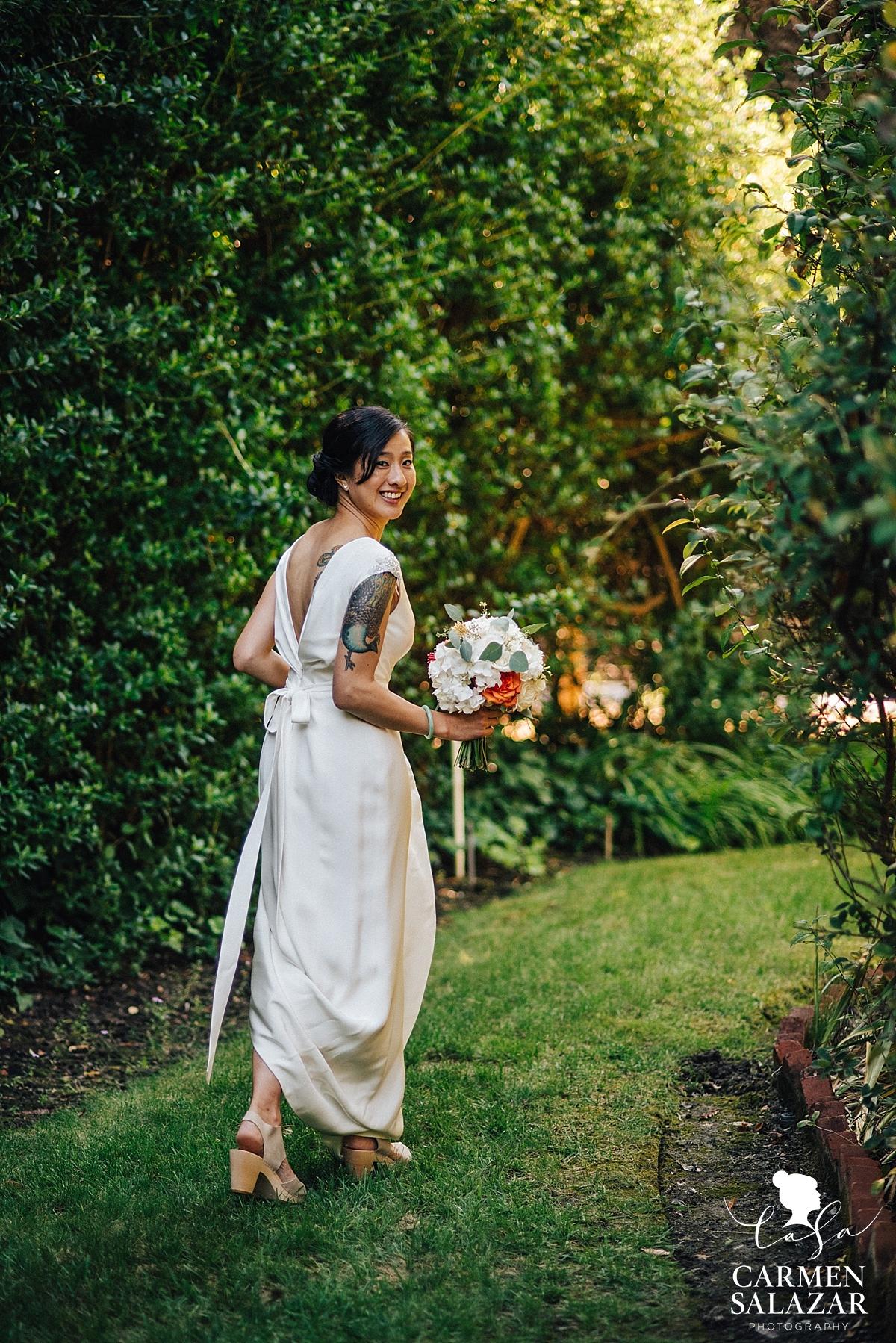 Happy bride leaving for outdoor ceremony - Carmen Salazar