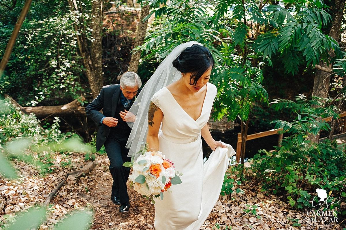 Bride crossing rustic bridge to the ceremony - Carmen Salazar